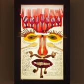 """Facce posate Applique artistica da parete della collezione """"Facce posate"""" realizzata da DanCalaMan con posate di plastica colorate su pannello luminoso a led in tonalità naturale. Cornice in legno. Il lavoro ha un significato introspettivo: lo stesso sfondo, che diviene visibile solo a lampada accesa, è un'iscrizione in Amarico sul significato ambivalente che l'autore attribuisce al volto.  Chi sei? C'è qualcosa di primitivo E di pauroso in te. Se non lo sapessi ti chiederei: - Da dove sei uscito? No. Non riesco ad evitarti. Dovresti farmi vergognare come per un peccato che non ho mai confessato Per un germoglio che non ho mai maturato. Ecco. Lo vorrei. Ma non riesco ad evitarti.  Chi sei? C'è energia, colore, forza ed emozione in te Se non lo sapessi ti chiederei: - Perché ancora mi soccorri? No. Non posso evitarti. Mi costringi a camminare su uno strettissimo crinale fra l'illusione e la follia. Ma in fondo a quel crinale c'è la speranza. Ecco. Mi fai paura. Ma non posso evitarti.  Artistic wall light from the """"Facce posate"""" collection made by DanCalaMan with colored plastic cutlery on a led light panel in natural shades. Wooden frame. The work has an introspective meaning: the same background, which becomes visible only when the lamp is on, is an inscription in Amharic on the ambivalent meaning that the author attributes to the face.   Who are you?  There is something primitive and scary about you. If I didn't know I would ask you: - Where did you come from? N. I'm not able to avoid you. You should make me ashamed as for a sin I never confessed as to a sprout that I never ripened. Here it is. I would. But I'm not able to avoid you.  Who are you? There is energy, color, strength and emotion in you. If I didn't know I would ask you: - Why are you still helping me? No. I can't avoid you. You force me to walk on a very narrow ridge between illusion and madness but at the end of that ridge there is hope. Here it is. You scare me. But I can't avoid you.  #firenzemadein"""